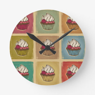 Vintage pattern made of cupcakes round clock