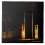 Vintage petrol pumps at night, Riddle, Oregon, Large Square Tile