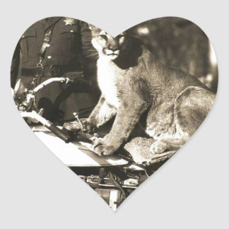 vintage photo of police officer on motorcycle puma heart sticker
