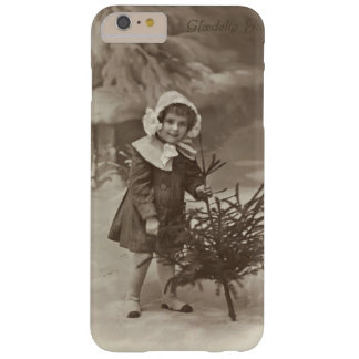 Vintage photograph of girl with a tree case