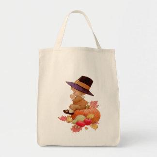 Vintage Pilgrim Boy Praying on Pumpkin Canvas Bags