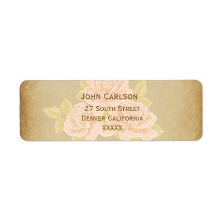 Vintage pink romantic roses with golden fleurdelis label