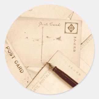 Vintage postcards round sticker