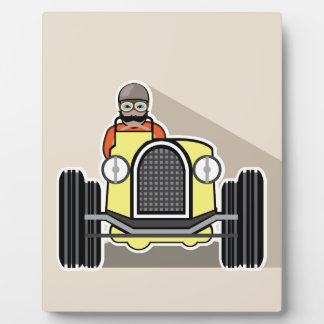 vintage race car with driver plaque