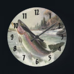"""Vintage Rainbow Trout Fish, Fisherman Fishing Round Clock<br><div class=""""desc"""">Vintage illustration sports design featuring a fisherman fishing in a river. A rainbow trout is splashing and jumping out of the water.</div>"""