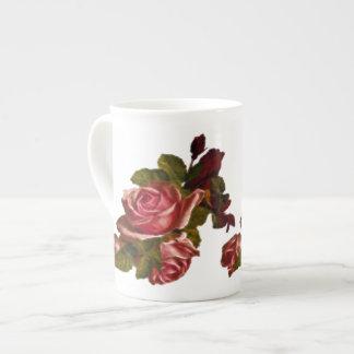 Vintage red rose bouquet tea cup