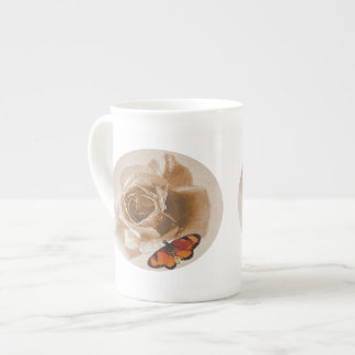 Vintage rose and butterfly tea cup