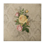 """Vintage Roses and Damask Ceramic Tile<br><div class=""""desc"""">Richly-textured design featuring a spray of vintage roses in yellow and pink with delicate engraved floral ornament on a distressed vintage linen toned damask background.</div>"""