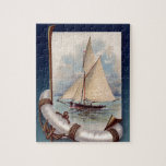 """Vintage sail boat with life saver, rope and anchor jigsaw puzzle<br><div class=""""desc"""">On this maritime gift is a vintage drawing of a sailing boat at sea. The picture is framed with a life saver (tube), rope and anchor. It is a wooden vessel with classic white sails. All these things are associated with ships and boats, making it an ideal gift to anyone...</div>"""