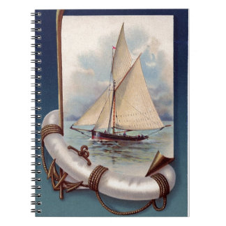 Vintage sail boat with life saver, rope and anchor notebook