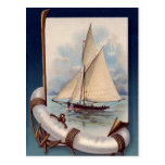 Vintage sail boat with life saver, rope and anchor post card