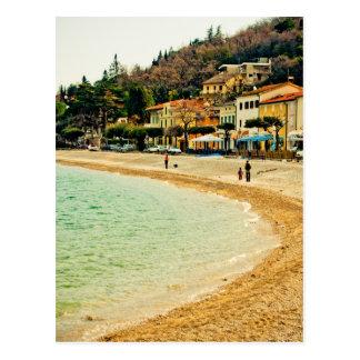 Vintage sandy seashore city sea houses and trees postcard