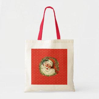 Vintage Santa Claus Against a Red Brick Wall Tote Bag