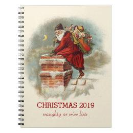 Vintage Santa Claus climbing into a chimney Notebook