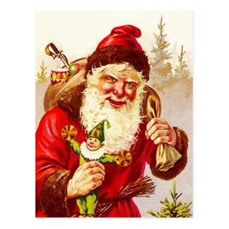 Vintage Santa con el bosque del arbolado del jugue Postal