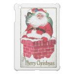 Vintage Santa en el tejado con el bolso de present
