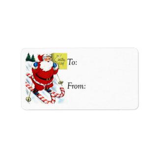 Vintage Santa en etiqueta del regalo de Skiis del Etiquetas De Dirección