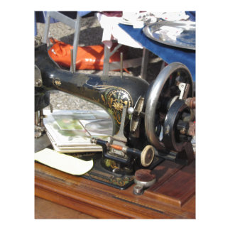 Vintage sewing machine at flea market letterhead