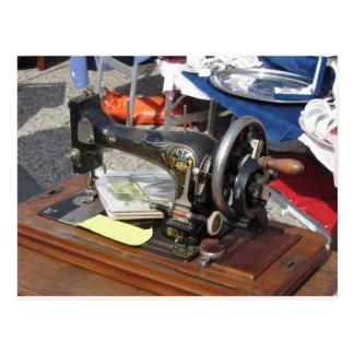 Vintage sewing machine at flea market postcard