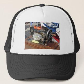 Vintage sewing machine at flea market trucker hat