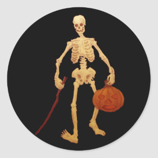 Vintage Skeleton Holding a Stick and Pumpkin Classic Round Sticker