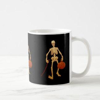 Vintage Skeleton Holding a Stick and Pumpkin Coffee Mug