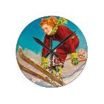 Vintage ski poster, lady ski jumper round wall clock