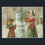 """Vintage Snowman Postcard<br><div class=""""desc"""">This is a vintage postcard illustration of a snowman being built.</div>"""