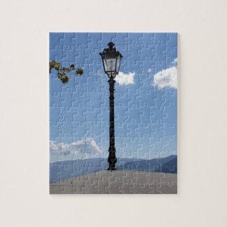 Vintage street lamp against blue sky jigsaw puzzles