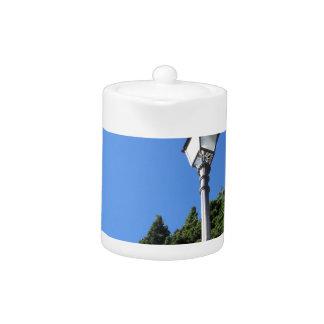 Vintage street lamp against blue sky teapot