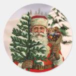Vintage style Santa Claus on winter background Round Stickers
