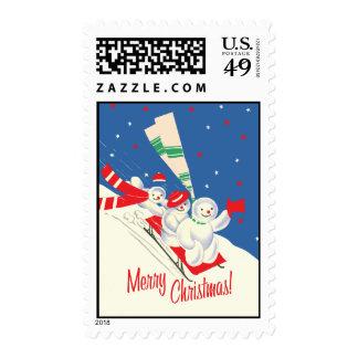 Vintage-Style Sledding Snowmen Christmas Stamp