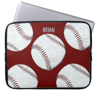 vintage styled baseball balls on red computer sleeves