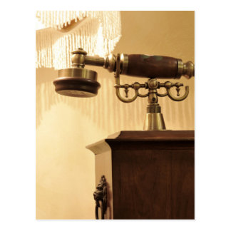 Vintage theme with antique lampshade and retro tel postcard