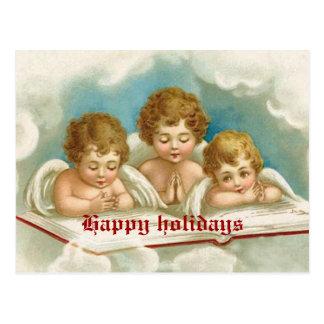 Vintage three cute praying angels postcard