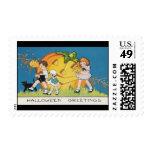 vintage-threelittle-kids-black-cat-large-pumpkin- postage stamps