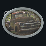 "Vintage truck oval belt buckle<br><div class=""desc"">Collectible belt buckle featured an old truck next to a fence. Great gift for the car buff.</div>"
