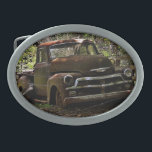 """Vintage truck oval belt buckle<br><div class=""""desc"""">Collectible belt buckle featured an old truck next to a fence. Great gift for the car buff.</div>"""