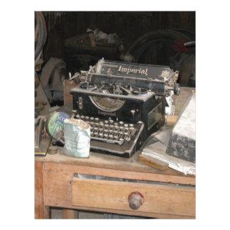 Vintage Type writer in dusty office workshop Letterhead