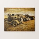 """Vintage Vehicles Jigsaw Puzzle<br><div class=""""desc"""">Three classic vehicles sit in a field for sale. Old texture laid on photograph creates vintage feel of old trucks and cars.</div>"""