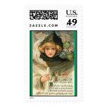 vintage-witch-black-hood-goblins-candle-postcard stamps