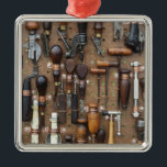 """Vintage Woodworking and leather craft tools Metal Ornament<br><div class=""""desc"""">This is a fabulous image of vintage or retro tools. Some of these are for working with leather and others are for woodworking projects. There are also old vintage styled can openers, and other relics of the past. Do you know someone who collects old tools? If so this would make...</div>"""