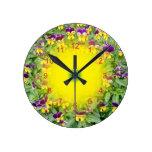 Viola flowers in a Spring Garden Round Wall Clocks