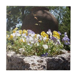 Violas In A Stone Trough. Ceramic Tile