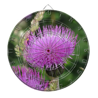 Violet wildflowers on the meadow dartboard with darts