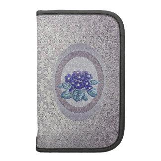 Violettes azules de plata en la flor de lis organizador