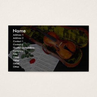 Violin and red rose on black background business card