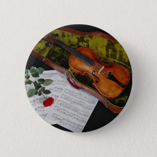 Violin and red rose on black background button