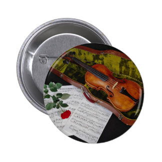 Violin and red rose on black background 2 inch round button
