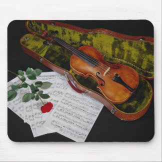 Violin and red rose on black background mouse pad